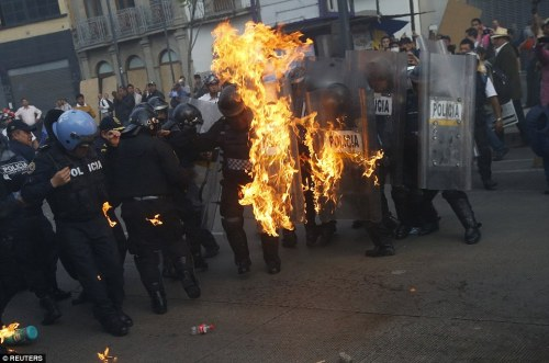 2918E67D00000578-3098775-Violence_Protesters_threw_Molotov_cocktails_at_police_eight_mont-a-24_1432715462705